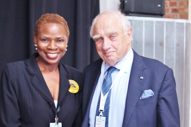 4.Justina Mutale wth Sir Peter Sutherland, United Nations Special Representative of the Secretary-General for Migration, at the Global Forum on Migrations and Development in Stockholm, Sweden (photo by Ingrid Marn)
